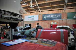 Apprentices working on a classic car