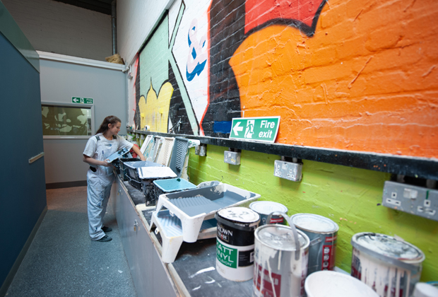 Apprentice preparing paint in training school